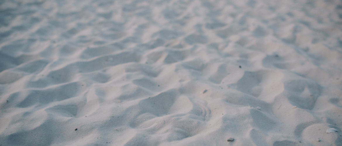 image of sand on a beach